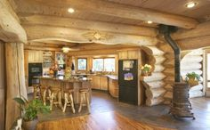 Pioneer Log Homes -- I would LOVE to have a kitchen like this :)