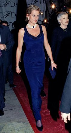 January 1995:Princess Diana wearing a  navy gown and pearl sapphire choker, to accept her CFDA Award in New York City.