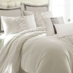 Refresh your master suite or guest room in chic style with this 8-piece comforter set, showcasing a central ruffle design and off-white hue.  Product: Queen: 1 Comforter, 1 bedskirt, 2 standard shams, 2 euro shams, 1 small decorative pillow and 1 large decorative pillowKing: 1 Comforter, 1 bedskirt, 2 king shams, 2 euro shams, 1 small decorative pillow and 1 large decorative pillowConstruction Material: Microfiber and polyesterColor: Off-whiteFeatures:  Embroidered detailsRuffle ...