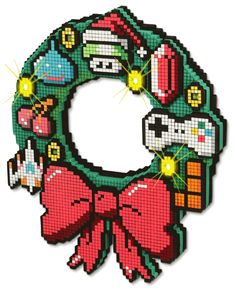 Nerd-a-licious gamer 8 bit holiday wreath. Now THIS would get me in the Christmas spirit, plus I'd leave it on my front door year round no doubt. Nintendo NES 4 EVA.