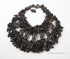 Robin Ayres – Black – Hundreds of vintage beads, Cracker Jack, Eppy, and celluloid charms, game pieces, wooden dominoes, and much, much more