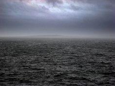 Aran Island across a dark sea. West coast of Ireland.