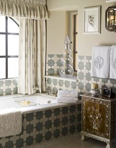 ***yes yes YES!!!***  Farrow & Ball's Old White paint on the walls has the same muted tone as Moroccan Cross and Star tiles by Ann Sacks. Curtains are Cowtan & Tout's Irina Sheer in Sky and Ivory. Indian inlaid cabinet from John Rosselli.