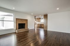 open floor plan living room, dining room and kitchen with modern finishes and stained cabinets