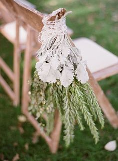 Beautiful and fragrant using rosemary delightful herbs  create beautiful textures and frangrences. Adorned with a vintage piece of lace. Tied to the end aisle chair giving the bride a adorned entrance to here one true love./comments:gemjunkiejewels