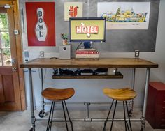 DIY standing desk (on casters) made from galvanized pipe and reclaimed wood.
