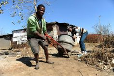 Gugulethu Informal Settlement outside Springs. Sipho Ndamase(22) with an illegal miner who did want to be named in Gugulethu Informal Settlement outside Springs. Picture: Dumisani Sibeko