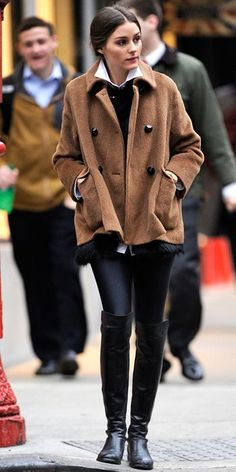Stylish Fall Outfit: oversize camel jacket over black Boots and Tights.