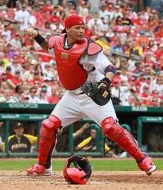 St. Louis Cardinals catcher Yadier Molina looks for another out opportunity after tagging out Pittsburgh Pirates' Josh Harrison in fourth in...