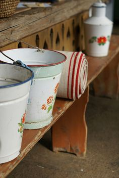 hungarian old country  : enamel - wood and wool stool -My Godmother had just the same to keep the water from the well. 1 for drinking, 1 for cooking - covered.  It was not so long ego .....