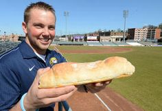 Nate Michel, the director for food and beverage for the West Virginia Power, holds what he believes to be the biggest pepperoni roll sold in the state. Pepperoni Rolls, Minor League Baseball, West Virginia, Beverage, Food, Drink, Essen, Meals, Yemek