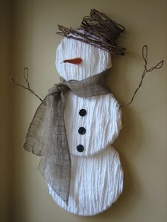 foam+yarn+burlap+wire+twine=snowman....I have a BOX of white/off white crepe paper.  I will NOT cut out the circles...but someone might.  SUper easy. Super cute.
