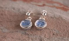 This unique earring design features rough cut yogo sapphires encased in a tiny locket.  Together the earrings contain 2.5 cts of rough cut yogos accented by sterling.
