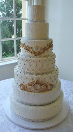 White and gold wedding cake by Joshua John Russell