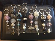 Make your own keychains! So easy! Just buy strands of beads and key rings. Use