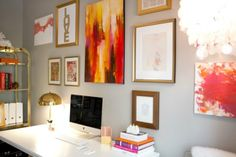 love the gold frames, grey walls, and pink/coral/orange colors