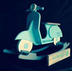 A truly stunning rocking horse, in retro scooter design. Custom designed by us, comes hand painted and with the optional name in front, as well