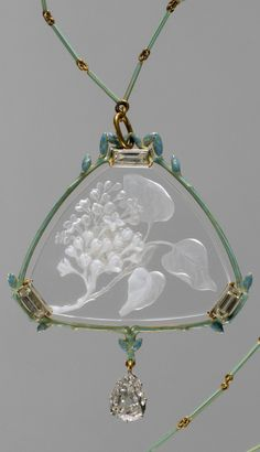An Art Nouveau gold, enamel, glass and diamond pendant with chain, by…