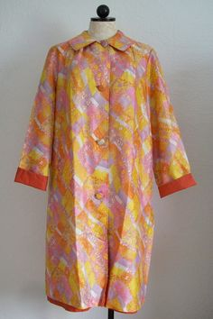 Vintage 1960-70's Reversible Floral and Orange Button Down Nylon Raincoat, $30.00