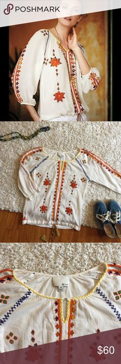 Anthropologie Greylin Stitched Dalia Blouse Sold out everywhere! This beautiful boho blouse is by Anthropologie brand Greylin. Airy fit with detailed embroidery and bead work. Colorful drawstring at waist. Condition: Excellent. Flaws: none. Anthropologie Tops Blouses