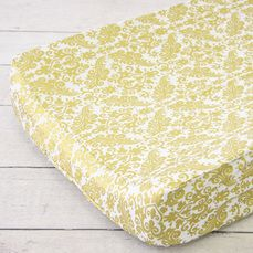 Caden Lane has inspired the Gold and White nursery trend once again with this Metallic Gold Damask Changing Pad Cover