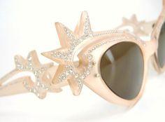 Hey, I found this really awesome Etsy listing at https://www.etsy.com/listing/182223068/vintage-starburst-cat-eye-sunglasses