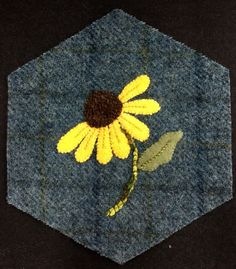 Painted Daisy -- Stems are 4 strands of Silken Chenille couched; Vein in the leaf is a 3 strand floss back stitch whipped w/ 2 strands of lighter floss; Veins in the petals are backstitch with 2 strands of floss; the center of the flower has cross stitches done with Silken Pearl.