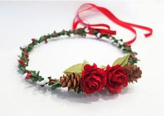This beautiful Christmas rose flower crown is a lovely holiday piece for winter or Christmas weddings or for holiday events and photos. With festive
