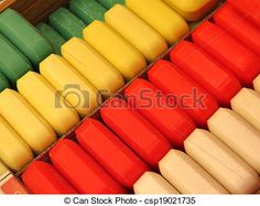 Rows of colourful bars of soap made with natural ingredients.