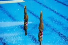 Canada's bronze medallists Emilie Heymans and Jennifer Abel hit the water in perfect alignment in the 3m springboard competition at the Aquatics Centre.