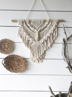 """Bring some hippie/boho style into your house with this medium sized wall hanging. Made with 6mm, 100% cotton rope in natural ivory. Hung on a wooden dowel or branch. The stick measures approximately 24"""". Macrame measures about 18"""" wide by 20"""" long (not including the hanging, if that"""