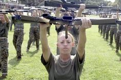 Female recruits at Marine Corps basic training. They're PT-ing (Physical Training) with rifles. Notice the mouth guards. These ladies go hard! #fitness #motivation #marines