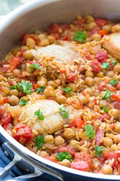 This One Pot Spanish Chickpea Chicken is an easy family friendly dinner! With brown rice, tomatoes and bell peppers, all cooked in one pan!