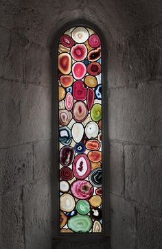 Sliced agate windows in Grossmunster Church, Zurich, Switzerland, German artist, Sigmar Polke. Seven windows depicting five figures from the Old Testament were created out of sliced agate, forming luminous rounds of variegated stone. The agate, most commonly associated with volcanic rock, is millions of years old, and was treated with special pigments to transform its normally earth-toned colouration, bringing a Murano glass-like quality to the windows of this 12th century Romanesque church.