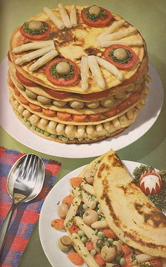 Very intricate and layered pancake. They are uniform size with carefully patterned vegetables, and probably cold upon serving. 1963