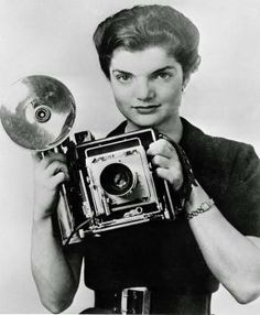 Jackie Kennedy's Life: Jacqueline Bouvier poses with a Speed Graphic press camera during her stint as an inquiring photographer for the Wash...
