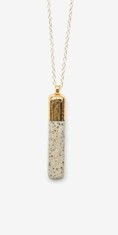 Back in stock, one of our best sellers the Gold Dipped Bar pendant. Grab it while you can!