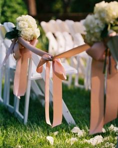 "See the ""Elegant Ribbon Aisles"" in our  gallery To add an elegant touch to a spring wedding ceremony, attach a wide satin ribbon to the back row of chairs to rope off the aisle. Then, place floral arrangements at the ends of alternating rows."