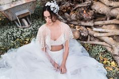 Helen & sienna bridal- Stunning lines of shining beads course down over soft ivory tulle, where they drip past a hem embellished with scallop upon glimmering scallop.