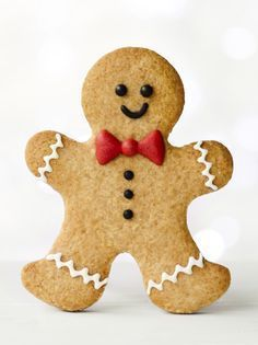 Gingerbread man by RuthBlack. Gingerbread man with red bow tie Gingerbread Christmas Decor, Gingerbread Man Cookies, Xmas Cookies, Christmas Mood, Christmas Cooking, Christmas Desserts, Christmas Treats, Christmas Biscuits, Holiday Appetizers