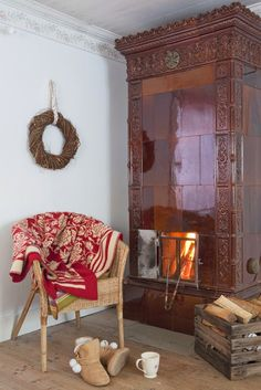 traditional swedish tile covered stove masonry heater | interior design + decorating ideas