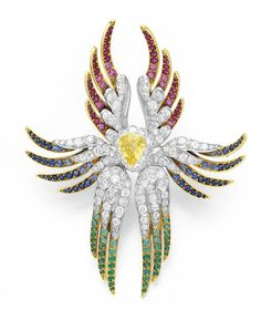 """A DIAMOND AND MULTI-GEM """"WINGED ANGEL"""" BROOCH, BY RENE BOIVIN   Set with a pear-shaped yellow sapphire, within a collet-set diamond surround, extending six circular and single-cut diamond articulated wings, each decorated with either rubies, sapphires or emeralds, mounted in platinum and 18k gold, 1967, with French assay marks and maker's mark  Signed René Boivin, Paris"""
