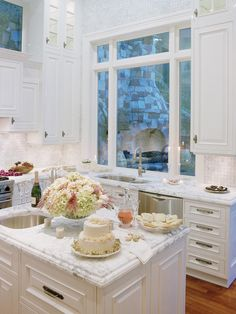Wow! White marble and white cabinets