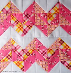 Chevron quilt block.    Tutorial here:    http://www.rileyblakedesigns.com/media/uploads/2013/01/21/files/RBD_ChevronBlock.pdf
