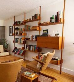 Mid-century, teak veneered tension pole shelving unit.