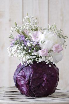 Such a neat idea for a natural vase. #flowers #vegetables #arrangements