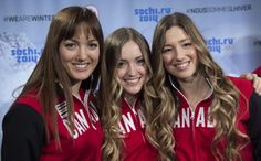 Sisters Maxime, Chloe and Justine Dufour-Lapointe, left to right, smile after being introduced as members of Canada's Olympic freestyle skiing team, Monday, January 20, 2014 in Montreal.