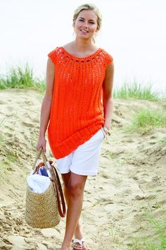 This crochet tunic, worked in a simple chevron treble stitch, is made in one piece with armhole openings forming cap sleeves. The neck edging, in treble, chain and double crochet, finishes the piece.