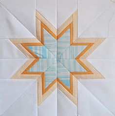 Six White Horses: The Lone Starburst paper piecing template.  J quilt?  fussy cut mermaids.
