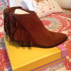 Brown Booties Brown Booties with super cute fringe tassels.  NWT and box. Size 8 1/2 never worn. Shoes Ankle Boots & Booties